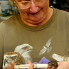 Wildlife caretaker, Jean Neal, feeds a baby squirrel at her home August 5 in Fairview. (Staff Photo by BILLY HEFTON)