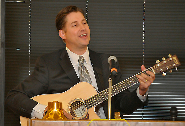 Peter Markes, Oklahoma Teacher of the Year and Waukomis native, sings a song during his talk to the Rotary Club Monday. (Staff Photo by BILLY HEFTON)