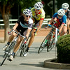 Women compete during the AMBUCS Twilight Criterium in downtown Enid Saturday, August 16, 2014. (Staff Photo by BONNIE VCULEK)