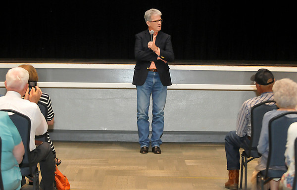 U.S. Senator Tom Coburn, M.D. listens to a question during a town hall meeting Monday at Enid's Convention Hall. (Staff Photo by BILLY HEFTON)