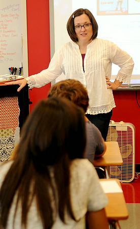 "Cathy Reed Benge (top center) visits with several of her new 6th grade students during Longfellow Middle School's ""Saddle Up"" orientation Wednesday, August 13, 2014. Enid Public School sixth grade students were  invited to special activities during the day at Emerson, Longfellow and Waller. (Staff Photo by BONNIE VCULEK)"