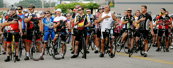 Riders pause for the National Anthem at the starting line during the AMBUCS 9th annual Tour de Trykes Saturday, August 16, 2014. (Staff Photo by BONNIE VCULEK)