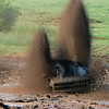 A competitor send up rooster tails of mud and water as it's tires spin after getting stuck during Molly Mayhem's Mud Bog Saturday August 9 in Hennessey. (Staff Photo by BILLY HEFTON)