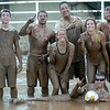 The Muddy Badgers, from Oklahoma City, win the 3rd annual Enid Miracle League Mud Volleyball Tournament at the Garfield County Fairgrounds in Enid, Okla. Saturday, August 02, 2014. (Staff Photo by BONNIE VCULEK)