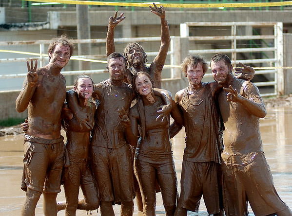 The Bench Warmers finish third during the 3rd annual Enid Miracle League Mud Volleyball Tournament at the Garfield County Fairgrounds in Enid, Okla. Saturday, August 02, 2014. (Staff Photo by BONNIE VCULEK)