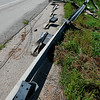 Traffic passes a damaged guardrail east of Lahoma following an early morning accident Monday. (Staff Photo by BILLY HEFTON)