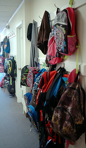 Children's backpacks line the halls of Zoe Bible Church during Kid's Cafe mentoring program Wednesday, August 27, 2014. The church provides activities for students from several Enid schools Monday-Friday, 3:30-6 p.m. (Staff Photo by BONNIE VCULEK)