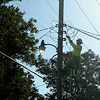 An OG&E line crew technician restores electrical power to homes in Enid Tuesday, August 19, 2014. Severe thunderstorms with wind gusts up to 70 miles per hour and ping pong ball sized hail moved across northwest Oklahoma causing power outages in several communities. (Staff Photo by BONNIE VCULEK)