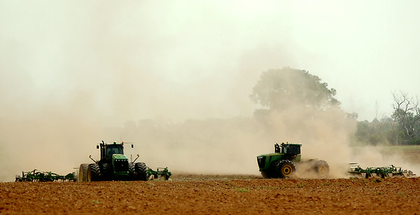 Area farmers prepare a field east of Highway 81 for next year's wheat crop Wednesday, August 27, 2014. (Staff Photo by BONNIE VCULEK)