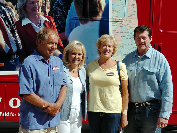 Oklahoma Gov. Mary Fallin (second, from left) pauses for a portrait with supporters and her husband, Wade Christensen (far right), during a campaign bus tour in Enid Saturday, August 23, 2014. (Staff Photo by BONNIE VCULEK)