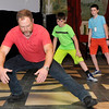 Rayden Alexander (right) and Gabriel Liggett (center) watch Tyler Woods as the demostrates the proper way to fall during a stage combat workshop during the Fly Film Festival Saturday August 6, 2016 at the Enid Symphony Ballroom Theater. (Billy Hefton / Enid News & Eagle)