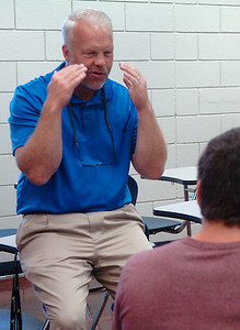 Thomas Rowe gestures as talks to students in his Youth Entrepreneurship class at Enid High School Thursday August 25, 2016. (Billy Hefton / Enid News & Eagle)