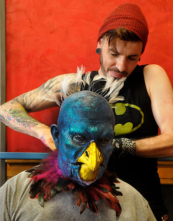 Nate Bright attaches feathers to Jon Haque during a make up deomstration at the Fly Film Festival Saturday August 6, 2016 at the Enid Symphony Ballroom Theater. (Billy Hefton / Enid News & Eagle)