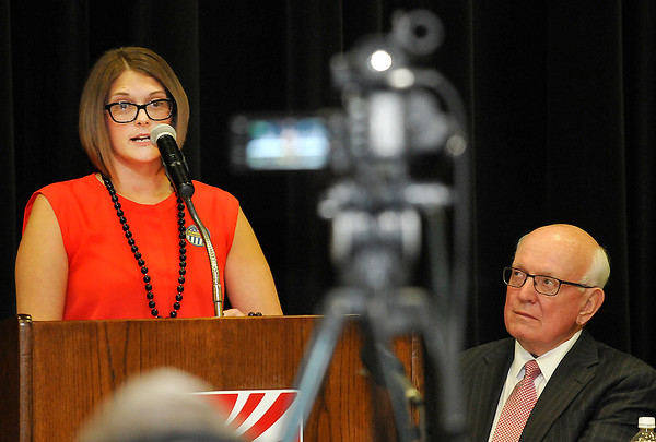 Bert Mackie (right) listens as Megan Gaddis talks about overcoming addiction during a town hall meeting on state questions 780 & 781 Thursday August 4, 2016 at the NOC Gantz Center. (Billy Hefton / Enid News & Eagle)