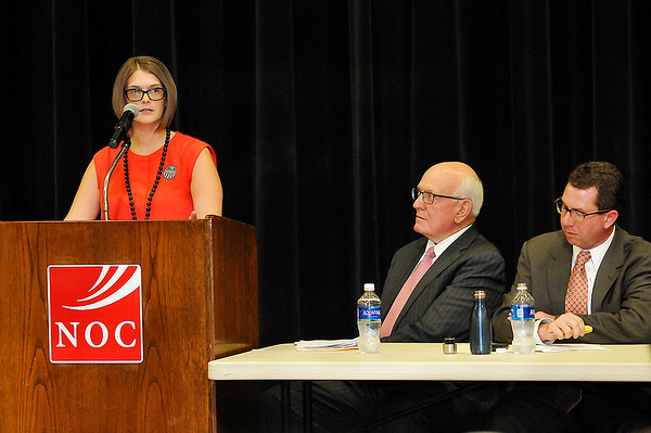 Bert Mackie (center) and Kris Steele (right) listen to Megan Gaddis talk about overcoming addiction during a town hall meeting on state questions 780 & 781 Thursday August 4, 2016 at the NOC Gantz Center. (Billy Hefton / Enid News & Eagle)