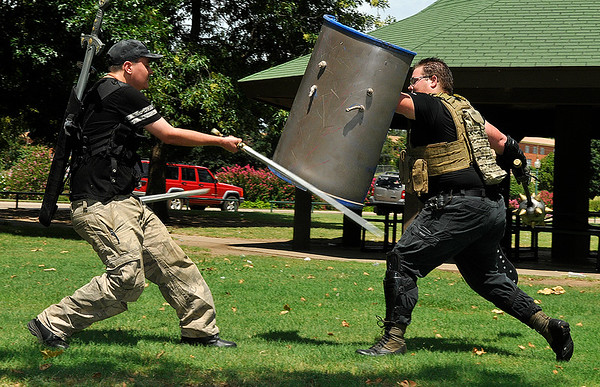 Ethan Russell (left) and Caleb House, members of the live action role playing club, Knights of the Crimson Cross, fight at Government Springs Park Monday August 8, 2016. (Billy Hefton / Enid News & Eagle)