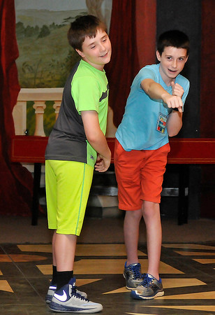 Rayden Alexander (right) and Gabriel Liggett take part in a stage combat workshop during the Fly Film Festival Saturday August 6, 2016 at the Enid Symphony Ballroom Theater. (Billy Hefton / Enid News & Eagle)