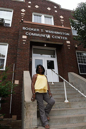 Barbara Finley stands on the steps the Booker T. Washington Community Center August 11, 2017. (Billy Hefton / Enid News & Eagle)