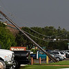 Down power poles along south Oakwood after a thunderstorm moved through Enid Wednesday August 16, 2017. (Billy Hefton / Enid News & Eagle)