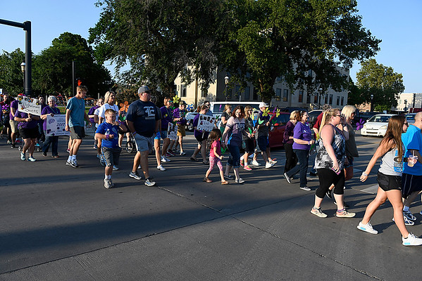 Walkers take part in the Walk to Enid Alzheimer's Friday August 4, 2017 in downtown Enid. (Billy Hefton / Enid News & Eagle)