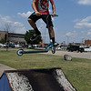 Nathan McDonald jumps his scooter over a ramp at the Enid Skate Park Thursday Aug 3, 2017. (Billy Hefton / Enid News & Eagle)