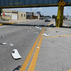 Debris litters east Maine street after a 5th wheel travel trailer struck the railroad bridge Thursday August 3, 2017. (Billy Hefton / Enid News & Eagle)