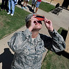 Staff Sgt. Kayla Mays looks at the solor eclipse through a solar viewer at the NOC Enid Astronomy Complex August 21, 2017. (Billy Hefton / Enid News & Eagle)