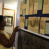 Barbara Finley talks about newspaper articles about Booker T Washington High School on display in the Leona Mitchell Museum August 11, 2017. (Billy Hefton / Enid News & Eagle)