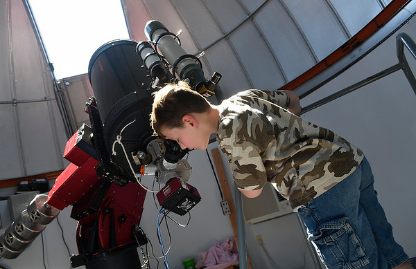 Phillip Fagan looks at the solar eclipse through the telescope at the NOC Enid observatory August 21, 2017. (Billy Hefton / Enid News & Eagle)