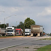 Large trucks drive on the 30th street porton of the truck route through Enid Wednesday August 2, 2017. (Billy Hefton / Enid News & Eagle)