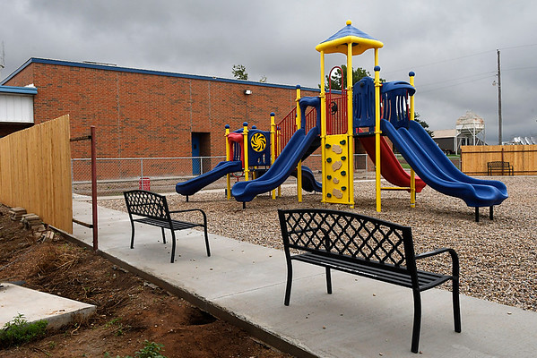 New playground equipment, benches and fences being built at Drummond schools. (Billy Hefton / Enid News & Eagle)