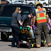 Enid emergency personnel help a woman who was involved in a two vehicle accident in the 100 block of west Willow Wednesday August 16, 2017. (Billy Hefton / Enid News & Eagle)