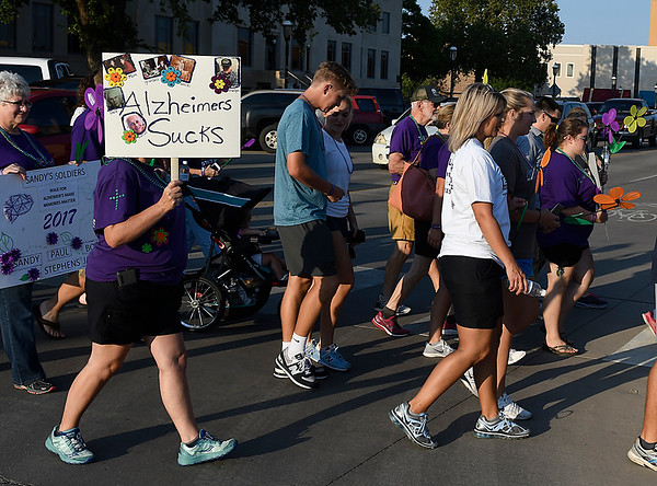 Walkers take part in the Walk to Enid Alzheimer's Friday August 4, 2017 in downtown Enid. More than 300 walkers took part in the event that raised almost $50,000. (Billy Hefton / Enid News & Eagle)