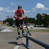 Nathan McDonald rides his scooter down a rail at the Enid Skate Park Thursday Aug 3, 2017. (Billy Hefton / Enid News & Eagle)