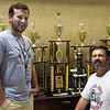Randy Johnson (seated) with his son, Matthew, in the Enid HIgh School choir room Tuesday August 15, 2017. (Billy Hefton / Enid News & Eagle)