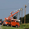 OG&E crews work to repair utility poles on west Chestnut Thursday August 10, 2017. (Billy Hefton / Enid News & Eagle)