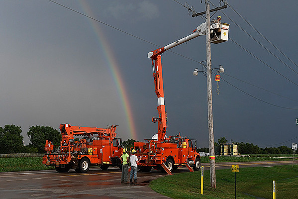 OG&E crews work to cut off the power to down power poles on 54th street between Chestnut and US 412 after a thunderstorm moved through Enid Wednesday August 16, 2017. (Billy Hefton / Enid News & Eagle)