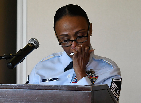 Keynote speaker, Master Sgt. Latanya Benson, pauses as she tells her story of abuse to those attending the seventh annual Forget Me Not Luncheon benefiting the Garfield County Child Advocacy Council Friday August 4, 2017. (Billy Hefton / Enid News & Eagle)