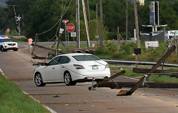 A man is trapped inside his car by down power lines on 54th street between Chestnut and US 412 after a thunderstorm moved through Enid Wednesday August 16, 2017. (Billy Hefton / Enid News & Eagle)