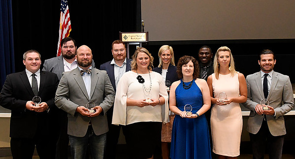 (left to right) Clint Claypole, Tim Campbell, Chip Baker, Dr. Chris Fagan, Dr. Valerie Trojan, Dr. Jessica Easterwood, Jessica Nickels, Demetrius Office, Ashlee Gore and Brady Sidwell were named the 10 Under 40 winners during the Enid Young Professionals 6th Annual 10 Under 40 Awards luncheon August 22, 2017 at the Central National Bank Center Grand Ballroom. (Billy Hefton / Enid News & Eagle)