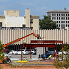 Construction workers put up the first pieces of steel at the downtown hotel Tuesday August 28, 2018. (Billy Hefton / Enid News & Eagle)