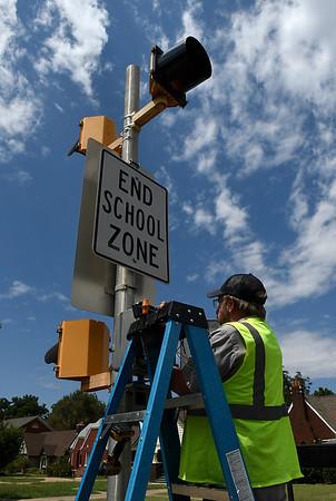 Darrell Stubbs works on a school zone light near McKinley Elementary Tuesday August 7, 2018. Enid Public Schools return to class August 15. (Billy Hefton / Enid News & Eagle)