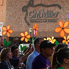 Walkers hold up flowers at the Walk to End Alzheimer's Friday, August 2, 2019 on the Garfield County courthouse square in downtown Enid. (Billy Hefton / Enid News & Eagle)