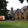 A moving truck sits outside the Champlin mansion Monday August 5, 2019. (Billy Hefton / Enid News & Eagle)