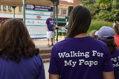 Maggie Base takes part in the Walk to End Alzheimer's for her papa, Oliver Hursh, Friday, August 2, 2019 on the Garfield County courthouse square in downtown Enid. (Billy Hefton / Enid News & Eagle)