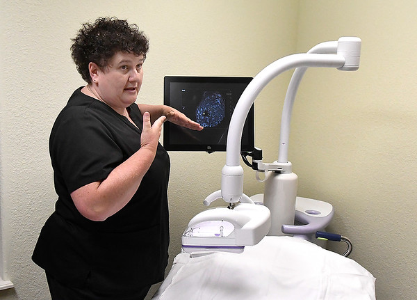 City Cartmill, lead tech at St. Mary's Women's Imaging Services, describes how the ABUS (Automated Breast Ultrasound System) works during an interview Tuesday, August 13, 2019.  (Billy Hefton / Enid News & Eagle)