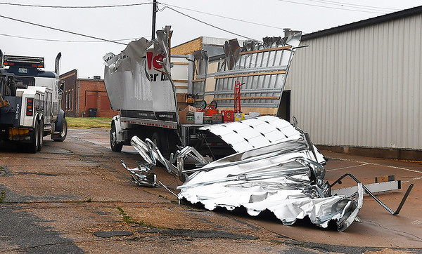 A cargo truck sits on 2nd street after hitting the Maine street bridge Thursday August 8, 2019. (Billy Hefton / Enid News & Eagle)