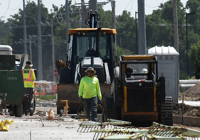 Construction crews continue work on north Cleveland street Monday, August 19, 2019 as the temperature rose to over 100 degrees. (Billy Hefton / Enid News & Eagle)