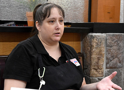 Jumbo West employee, Chrissy Bell, gestures during an interview August 6, 2019. Bell performed CPR on a fellow employee after he collapsed with a heart attack and she is credited with saving his live. (Billy Hefton / Enid News & Eagle)