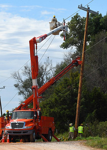 OG&E crews work to replace down utility poles on the westside of Ames Tuesday, August 13, 2019. (Billy Hefton / Enid News & Eagle)